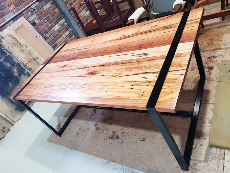 District Furniture reclaimed door turned into a modern table top with custom fabricated metal frame