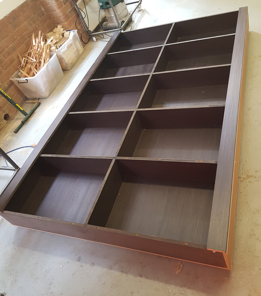 bookcase with solid timber edges painted to match veneer