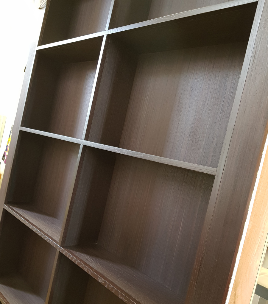 solid timber edges on custom veneered bookcase