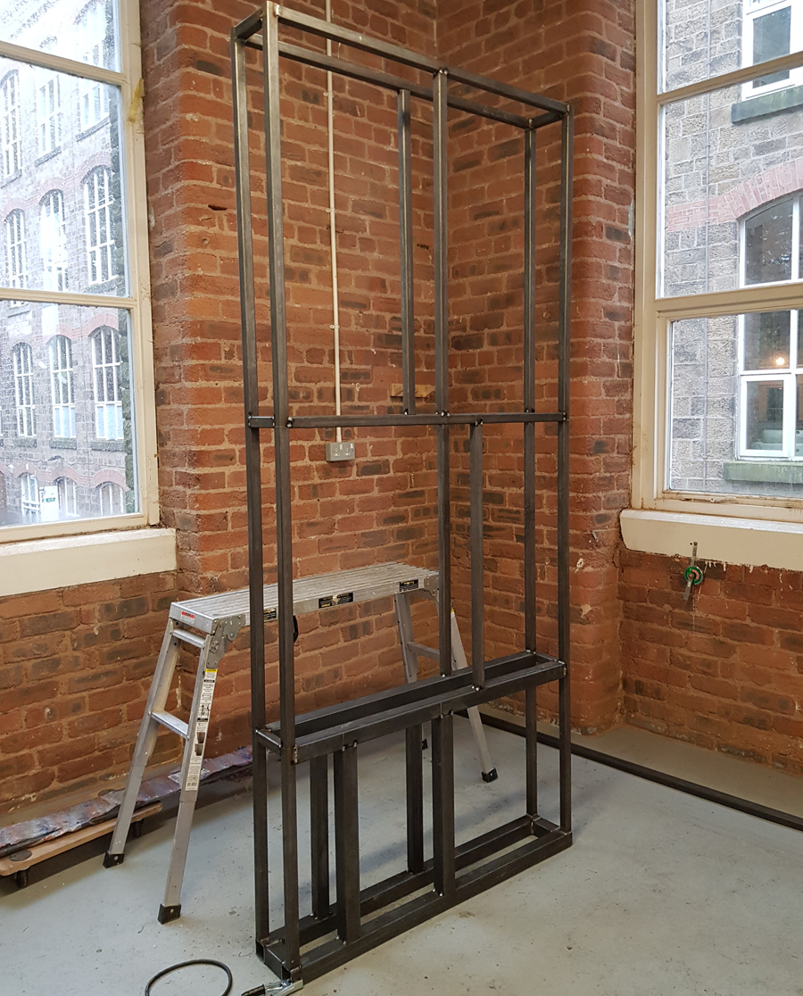 Large metal fabricated frame for wall section