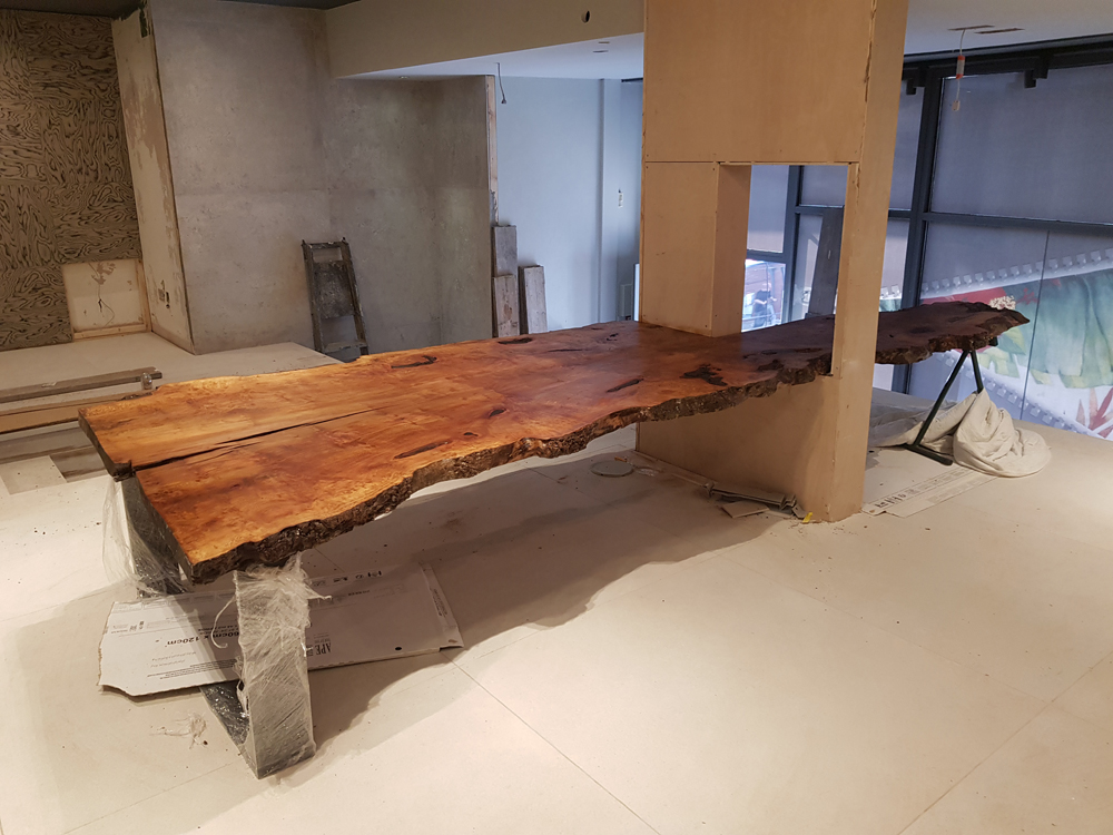 London plane custom made table top passing through hole in the wall
